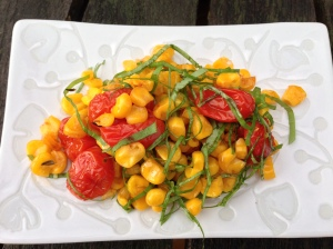 Isn't this a pretty dish to set before...well...anyone? Roasted corn and tomatoes with basil.